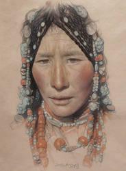 Portrait of the Tibetan girl wearing a headdress