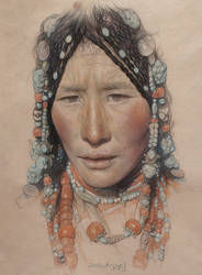Portrait of the Tibetan girl wearing a headdress