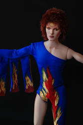 David Bowie doll in his iconic flame unitard by dollsbydell