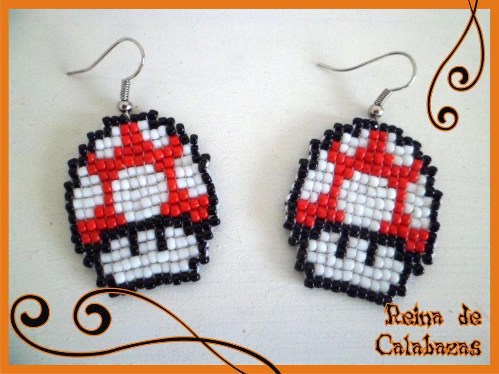 Red mushrooms earrings by anubis-pumpkinqueen