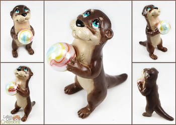 Otter Pup with Marble