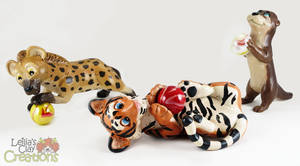 Hyena, Tiger and Otter with Marbles