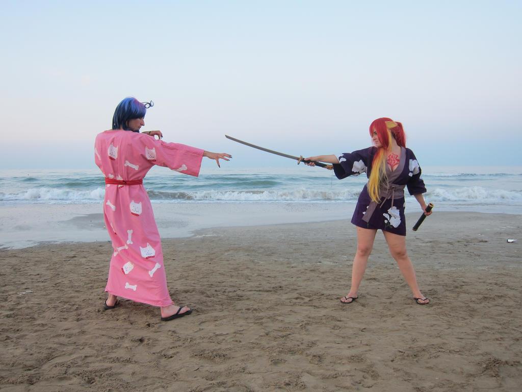 fighting on the beach by feelyah on deviantart