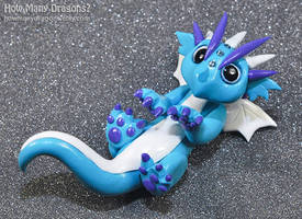 Little Blue Cat-dragon by HowManyDragons