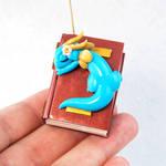Baby Bookwyrm Ornament