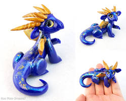 Smiling Blue and Gold Glass-eyed Dragon by HowManyDragons