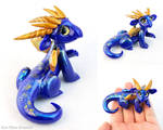Smiling Blue and Gold Glass-eyed Dragon
