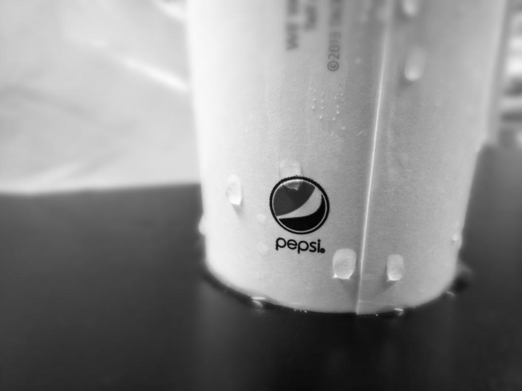 Soda bottle: Pepsi logo. Monochrome image. by lookincool45