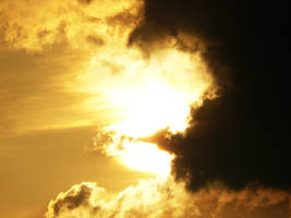 Sun behind the clouds 2