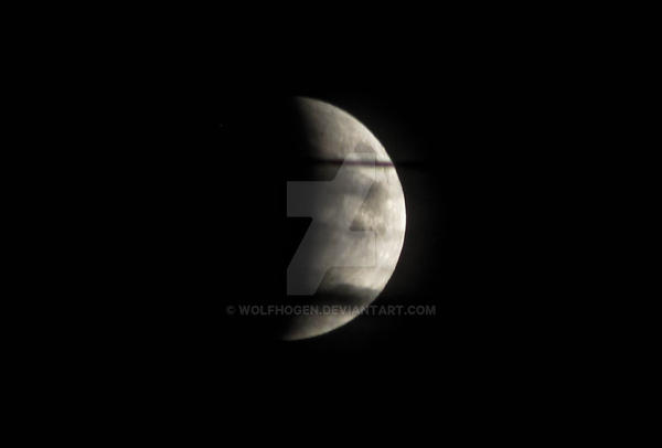 partial lunar eclipse with clouds 09272015 by wolfhogen