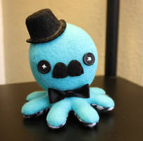 Turquoise and houndstooth octopus plush