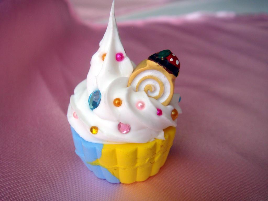 Banana Cream Swirl Cupcake by Lustfulwish