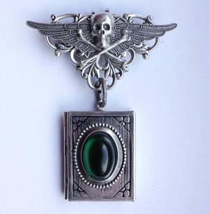 Skull locked book pendant