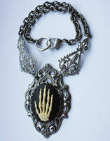 Skeleton hand necklace by Pinkabsinthe