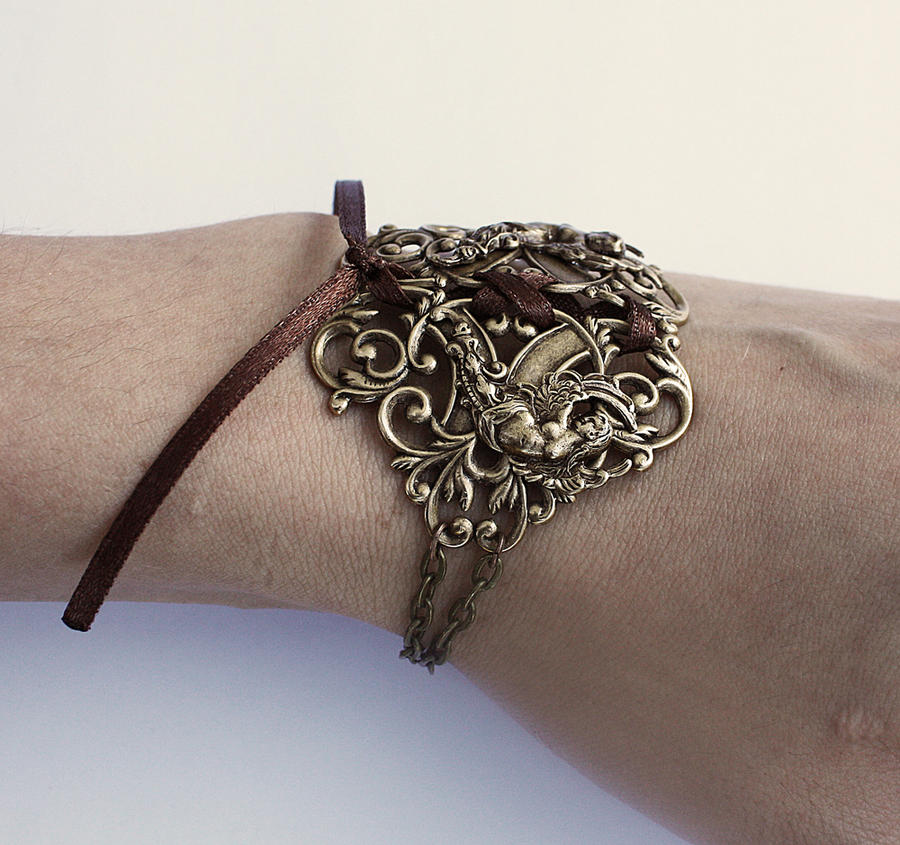 Winged goddesses brass bracelet by Pinkabsinthe