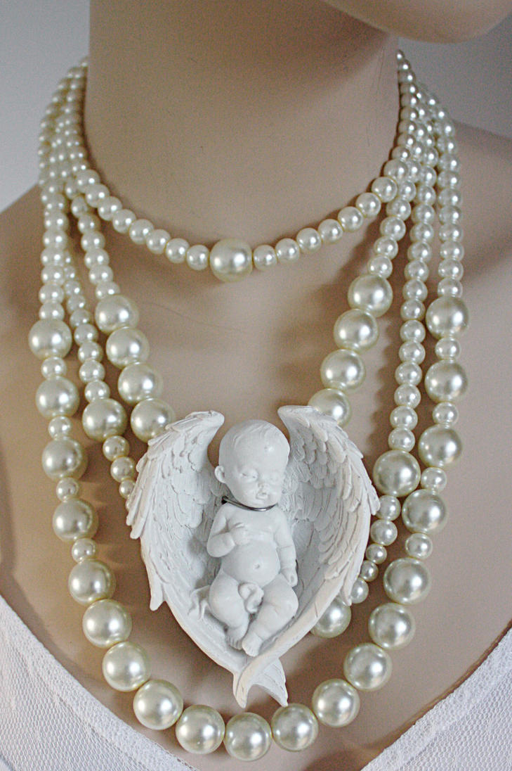 Cherub pearl necklace by Pinkabsinthe