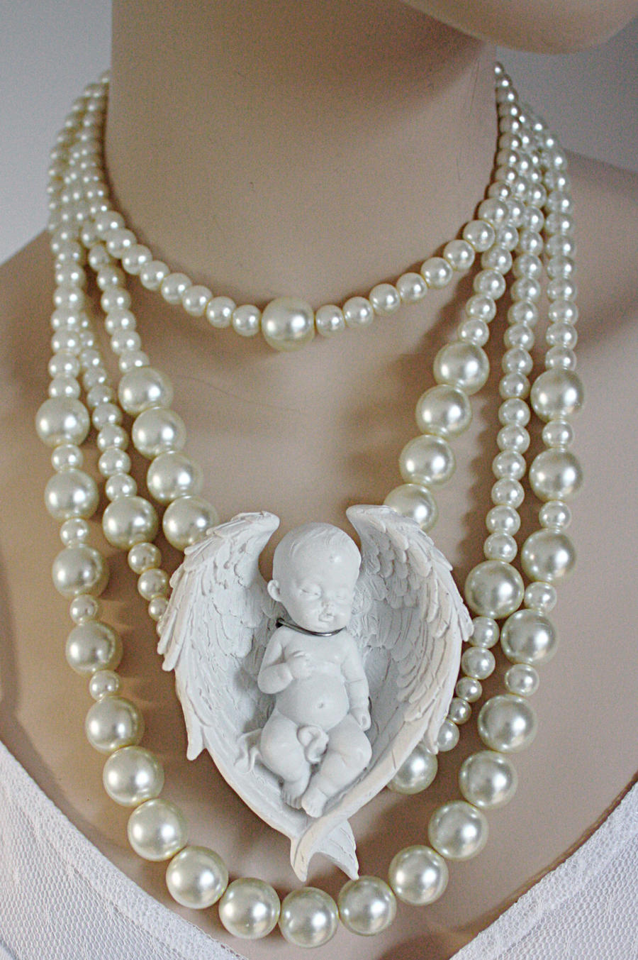 Cherub pearl necklace by Pinkabsinthe