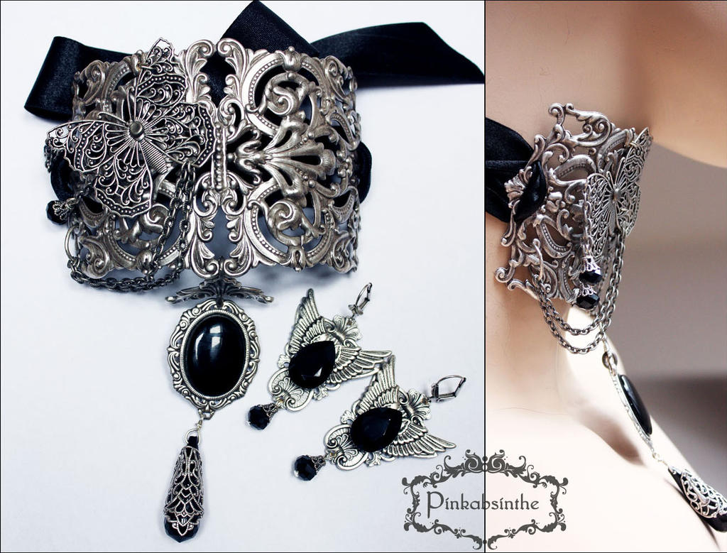 Filigree neck corset and winged earrings  II