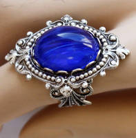 Sapphire blue gothic ring by Pinkabsinthe