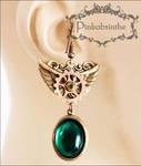 Winged emerald green long earrings