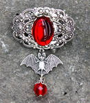 Bloody vampire bat brooch