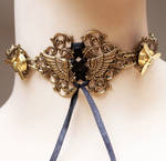 Propeller winged brass choker