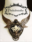 Chest tattoo moth winged Octopus necklace