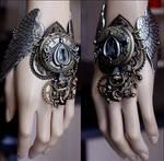 Winged watch cuff by Pinkabsinthe