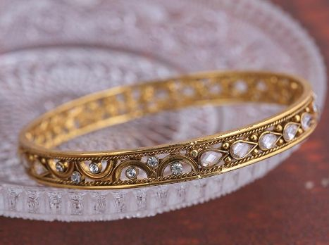 A Beautiful Pair Of Gold Plated Antique Kundan Ban by acsentialsindia