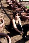 Rachel Dashae Among the Flowerpots