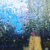 Lights / glass / raindrops