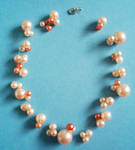 Unsymmetric pearl necklace