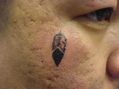 Feather Tattoo on Cheek