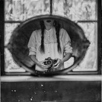 self-portrait with camera by RapidHeartMovement