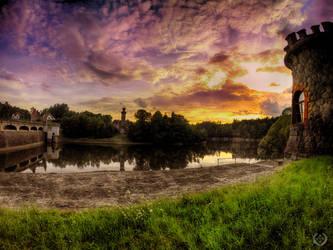 Sunset over the dam by MarekLeschinger