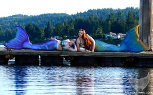 Lounging Mermaids by Mermaid-Iona