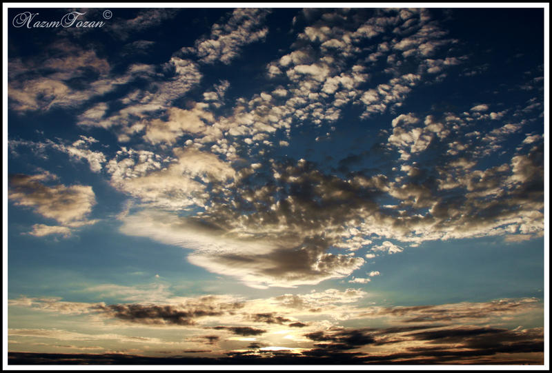 Sun Sets In The Clouds by nazimtozan