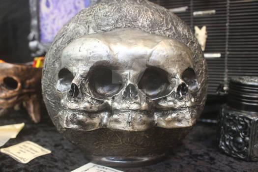 Triple Fetus skull bottle  close up.