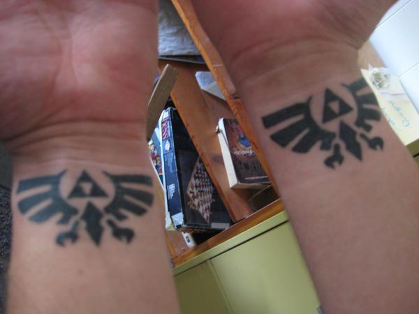 Double wrist zelda tattoos by oath keeper on deviantart for Triforce hand tattoo