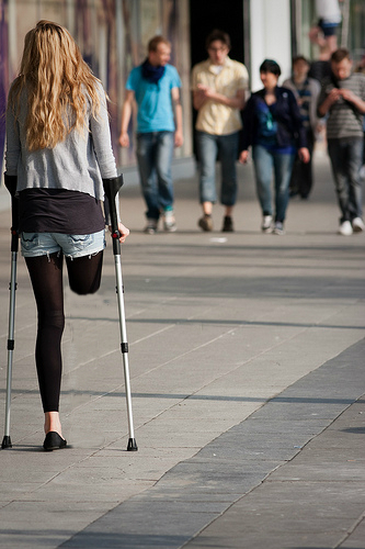 Amputee Women On Crutches