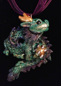 Chinese dragon pendant with gold ball