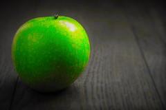 Green apple in black-white
