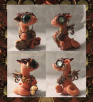 Little orange steampunk dragon