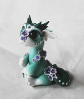 Silly flower dragon by BittyBiteyOnes
