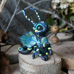 Black and Blue Moth Dragon by BittyBiteyOnes