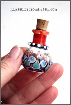 Red and blue miniature glass bottle