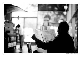 quietly reading at starbucks.. by cweeks