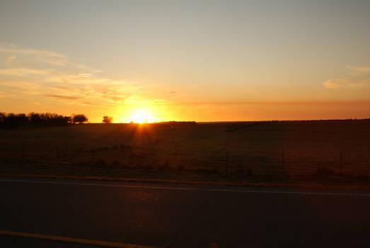 Lovely sunset background image driving dark road