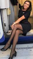 Stewardess sitting, crossed legs