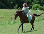 Medieval girl riding a horse